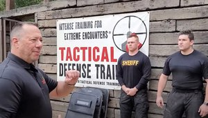 Matt Schaefer, left, prepares to demonstrate Presidia Gel and its antidote to a group of SWAT officers in training. Schaefer says the products fill a critical gap when it comes to the less-lethal tools available to law enforcement.