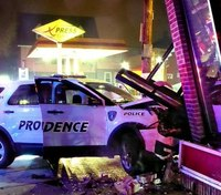 RI officer crashes patrol SUV into building to avoid vehicle