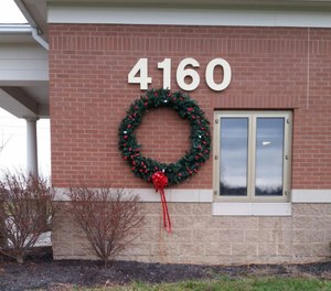 """As part of the """"Keep the Wreath Red"""" campaign, each fire station displays a holiday wreath, large enough to be seen by passersby or vehicle traffic, and decorated in all red holiday lights. Then for every fire, one white light replaces a red light on the wreath. (Photo/Robert Rielage)"""