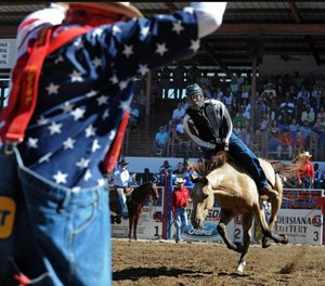 Inmates participating in the rodeo all wear helmets, protective vests and a mouth piece.