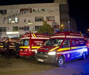 Ambulances outside the site of a fire that occurred in a nightclub in where a heavy metal band's pyrotechnical show sparked a deadly. (AP Photo/Vadim Ghirda)