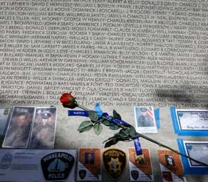 A rose is placed at the wall with the names of fallen police officers at the National Law Enforcement Officers Memorial in Washington during the National Police Week.