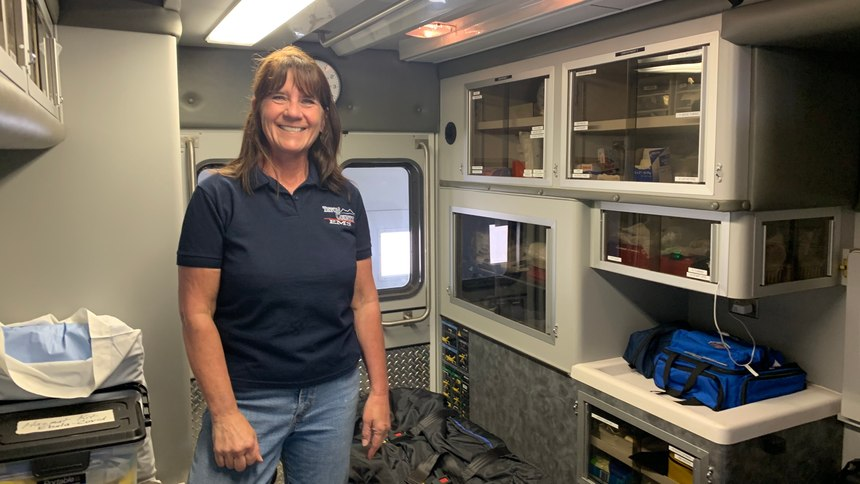 Dutton EMS Crew Chief Colleen Campbell shows off an ambulance at the Dutton ambulance barn.