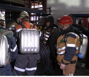 This Feb. 26 photo provided by Russian Emergency Situations Ministry press service shows rescuers getting on an elevator in Vorkuta, Russia. (Ministry of Emergency Situations press service via AP)