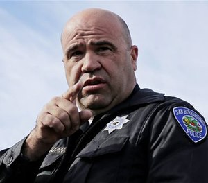 San Bernardino Police Chief Jarrod Burguan takes a question at a press conference.
