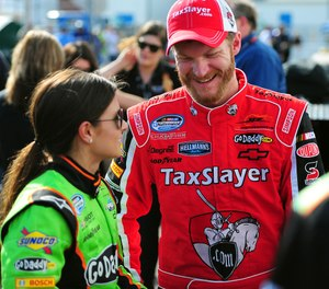 NASCAR Nationwide Series drivers Danica Patrick and Dale Earnhardt Jr. talk following their qualifying laps for the DRIVE4COPD 300 at Daytona International Speedway. (Photo/Tribune News Service by Jeff Siner/Charlotte Observer)