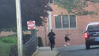 'Chilling' video: Man runs around pointing gun at officers, bystanders