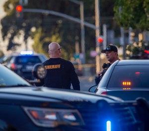 Sacramento police continue to block off the scene where a police officer was fatally shot in Sacramento, Calif., Thursday, June 20, 2019. (AP Photo/Don Thompson)