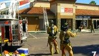 Firefighter falls through roof at restaurant fire