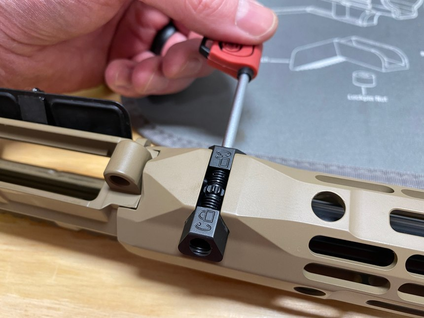 The mounting system for the R-One handguard is really well done. It cinches up tight and tucks away nicely.