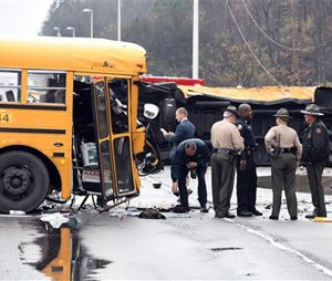 """Authorities work the scene of an accident involving two school buses in Knoxville, Tenn., Tuesday, Dec. 2, 2014. Knoxville Police Department spokesman Darrell DeBusk said """"several students have been injured and are in the process of being transported to the hospital."""""""