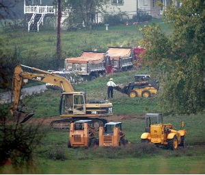 Demolition workers remove debris from the West Nickel Mines Amish School after demolition crews razed the schoolhouse before dawn in Nickel Mines, Pennsylvania, Thursday, October 12, 2006. (Barbara L. Johnston/Philadelphia Inquirer/MCT)