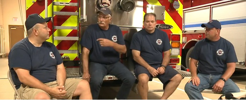 From left to right: Bob Stanczyk, Jeff Walczak, Tony Scholten and Chief Mark Chesak discuss the fateful incident.
