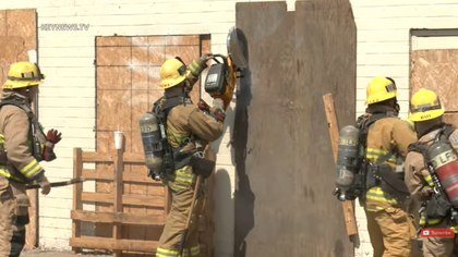 Got to get in! LAFD crews use several tools to access building interior
