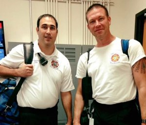 Battalion Chief Dan Miller (right) called 911 and told an operator that he thought he was having a heart attack.