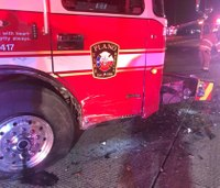 Texas firefighter hurt after car crashes into ladder truck on scene