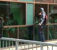 Officers dressed as superheroes surprise children at hospital