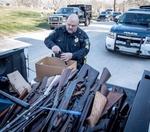 Ninety-eight guns were found across the home.
