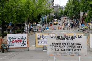 A sign on the street welcomes visitors and a list of demands is posted Wednesday, June 24, 2020, inside the CHOP (Capitol Hill Occupied Protest) zone in Seattle. Image: AP Photo/Ted S. Warren
