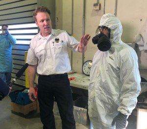Setting up the testing site requires many steps related to the testing kits, teaching personnel how to do the swab, proper PPE and more. (Photos/Courtesy Seattle Fire Department)