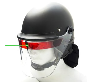The Super Seer Lazer-Shield is a self-adhesive strip that can be applied horizontally on any clear face shield to protect officers' eyes against laser beam attacks while maintaining a clear, unobstructed field of view.