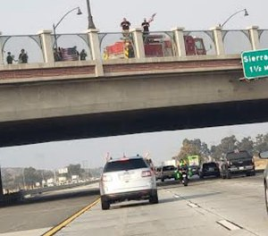 Norton says a cellphone photo taken by her son less than a minute before the crash bolsters a firefighter's claim about the presence of the Engine 79 crew on the overpass.