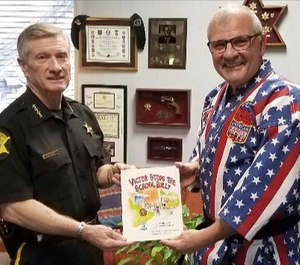 Richland County Sheriff Leon Lott receives a copy of