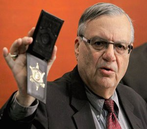 In this Dec. 21, 2011 file photo, Maricopa County Sheriff Joe Arpaio shows his badge.