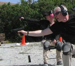PoliceOne Editor-at-Large Doug Wyllie dumps an empty magazine and reaches to reload during a drill to simulate responding to a sudden ambush attack in a restaurant or some other place where you'd be seated.