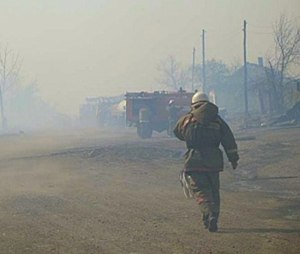 In this undated photo taken from the Website of the Ministry for Emergency Situations, Khakassia branch, a firefighter extinguishes the fire in Khakassia, a region in southeastern Siberia, Russia.(Ministry for Emergency Situations, Khakassia branch in Siberia via AP)