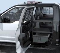 Vehicle storage and prisoner transport built for pickup-driving cops