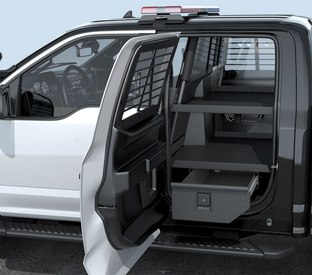 Vehicle storage and prisoner transport built for pickup-driving cops