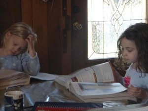 Two of the girl's studying for EMT class.