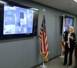 Sacramento County District Attorney Anne Marie Schubert displays a video from a Sacramento County Sheriff's helicopter in last year's fatal shooting of an unarmed black man, during a news conference in Sacramento, Calif., Saturday, March 2, 2019. (AP Photo/Rich Pedroncelli)