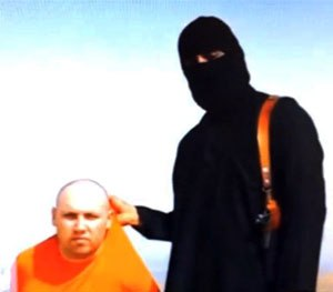 This still image from an undated video released by Islamic State militants purports to show journalist Steven Sotloff being held by the militant group. Imagine the chilling effect on the collective American psyche from some lone-wolf Jihadi kidnapping a random citizen on American soil and posting an online video of their beheading. (AP Image)