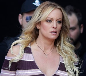 "Adult film actress Stormy Daniels arrives for the opening of the adult entertainment fair ""Venus"" in Berlin. Daniels has sued the Columbus police department for $2 million over her arrest at a strip club last summer. The federal defamation lawsuit filed Monday, Jan. 14, 2019, alleges officers conspired to retaliate against Daniels for her sex allegations concerning Donald Trump before he became president. (AP Photo/Markus Schreiber, File)"