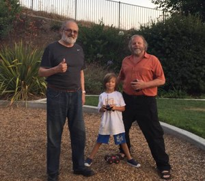 Mike Taigman, his son Ax, and Jack Stout at a park near Stout's home. (Photo/Courtesy of Mike Taigman)