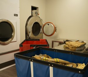 Advanced cleaning subjects garments to laundering in a washer/extractor, a specialized laundry machine that is of a frontloading design and generally has a capacity of 30 pounds (of laundry) or more. (Photo/McKinney Fire Department)