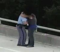 Video: NC officer hugs suicidal man after talking him off bridge ledge