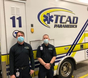 Paramedics Shea Lathrum and Brandon Busch were at the right place at the right time to save an unconscious driver from a vehicle fire.