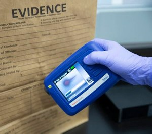The portable, handheld TruNarc Narcotics Analyzer can analyze and identify a multitude of drugs and other substances in the field in a matter of seconds. Because it can identify most through their packaging, it doesn't require actual contact with the substances themselves, which helps keep officers safe from accidental exposure. (image/Thermo Scientific)