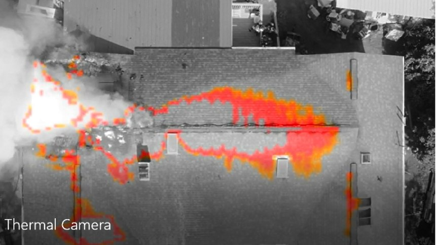 A drone uses a thermal imager at a house fire.