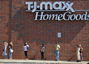 Shoppers wait to get into a newly reopened TJ Maxx and Homegoods in Massachusetts. Big box stores and the charitable foundations they operate have continued to serve their communities throughout the pandemic. Image: T&G Staff/Christine Peterson via TNS