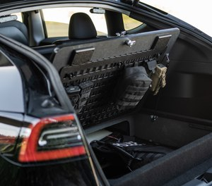 Customized storage from TruckVault in the vehicle's hatchback secures weapons and essential gear.