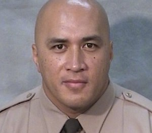 Officer Toamalama Scanlan was shot after responding to another officer's plea for help.