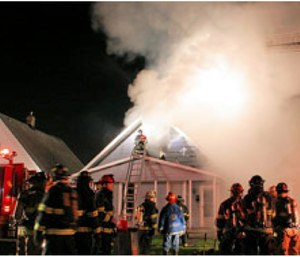 Indianapolis firefighters work at the scene of a fatal house fire.(Photo: Tod Parker/Phototac.com)