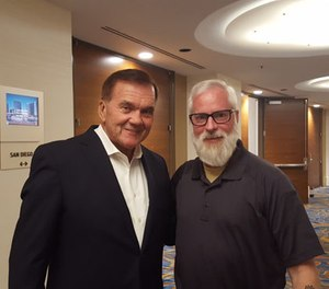 Former Secretary of Homeland Security Tom Ridge (left) takes time to visit with PoliceOne Editor-at-Large Doug Wyllie. (PoliceOne Image)