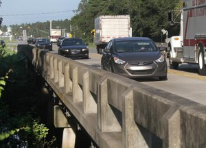 Traffic rolls across the Tomoka River Bridge in Daytona Beach, Florida, during a morning rush hour in 2018. Image: News-Journal/David Tucker via TNS