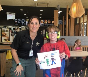 The author is pictured here with Jen, who is on the autism spectrum and uses earmuffs to reduce noise overstimulation.