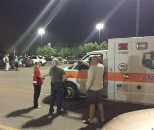 Emergency personnel stand by as evacuees gather at the Foothills Mall early July 2, 2015, in Maryville, Tenn., after they were forced to leave their homes when rail car carrying a flammable and toxic gas derailed and caught fire. (Brittany Bade/WBIR.com via AP)